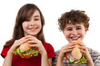 Kids eating big sandwich isoalted on white background