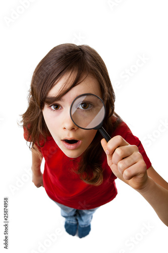 Girl holding magnifying glass isolated on white