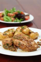 Roast pork with baby potatoes