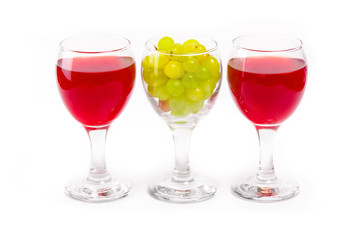 Arrangement of glasses of wine and grapes