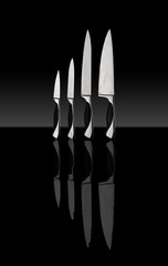 kitchen knives on a black background