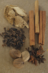 Assorted spices in brown background