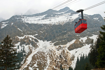 Red cable car railway and Pilatus Mountain at Lucern Switzerland