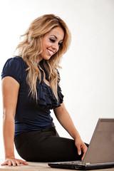 Attractive twenties hispanic brunette woman on laptop