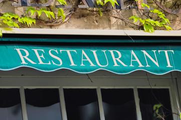 Signboard by restaurant