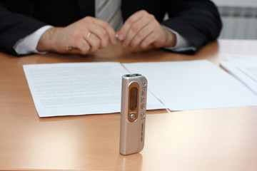 Businessman interviewing with a dictaphone