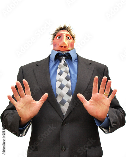 Businessman with shrunken head calming the situation