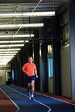 Man Running On An Indoor Track