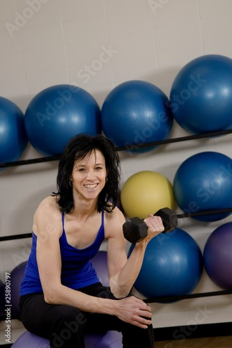 Woman At A Gym Working Out