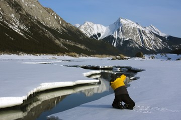 Person On The Snow In Mountain Range, Alberta,Canada