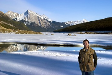 Man Standing In Front Of Medicine Lake,Alberta,Canada