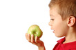 Child eats an green apple