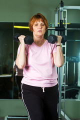 Mature Woman working out in gym