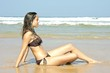 Beautiful young woman relaxing at the ocean