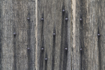 Old wooden planks with rusty nails