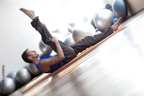 fusion of mind and body - man practicing pilates