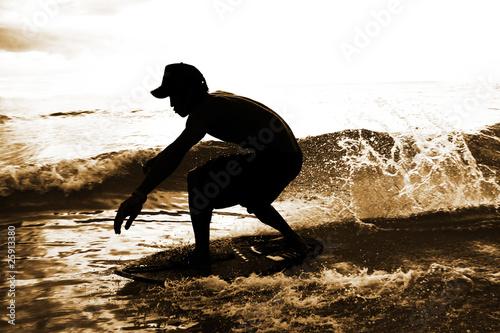 skimboarder in water drops