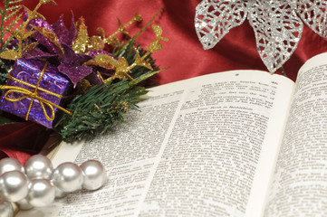 Bible open to  Luke 2 with Christmas decorations