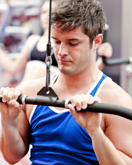 Self-assured male athlete practicing body-building
