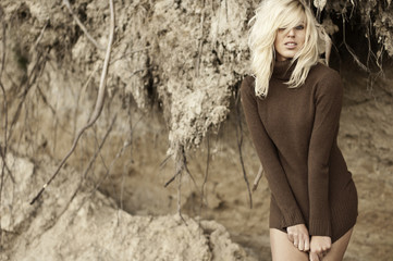 Beautiful woman wearing brown sweater