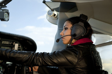 Woman flying airplane
