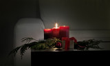 christmas decor by candlelight on coffee table by sofa