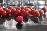 christmas bauble decorations on a glass table