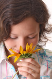 Happy woman sniffs sunflower. Close-up poster