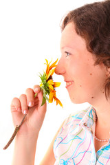 Beautiful girl sniffs a flower