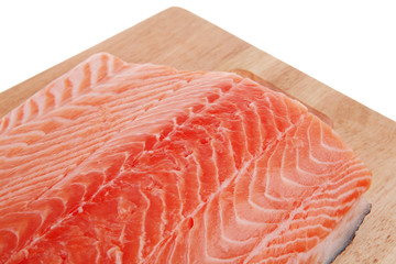 fresh raw salmon fillet on wood