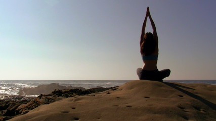 Yoga stretching by the ocean - HD