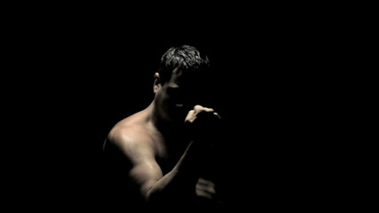 Boxer Spars in the Shadows