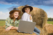 Two country girls with notebook