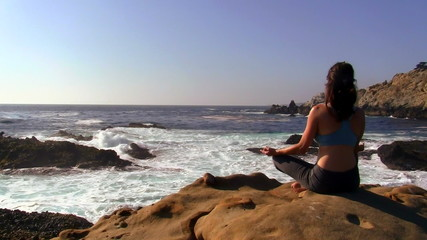 Young woman meditates by the sea - HD