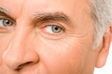 Part of senior man face poster