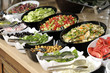 Leinwandbild Motiv Buffet style food in trays
