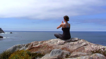 Yoga meditation in coastal landscape - HD
