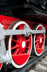 Old steam engine wheels close-up