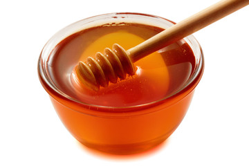 Wooden dipper with bowl of honey.