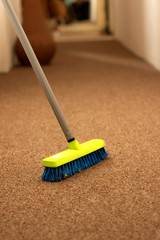 Plastic broom on carpet