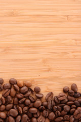 Coffee beans on brown background