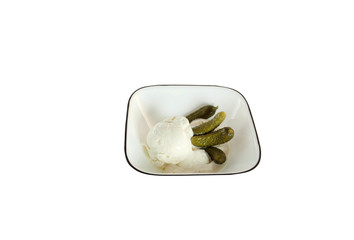 Small pickles and ice cream in a bowl