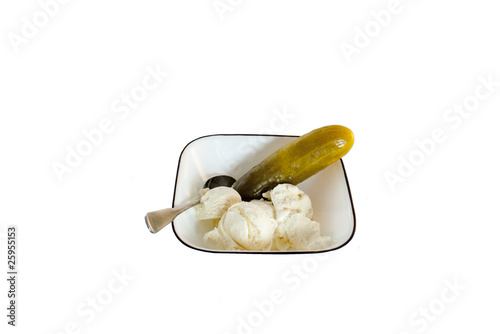 Pickle and ice cream in a bowl