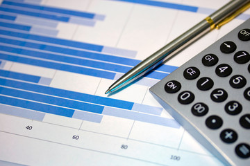 Financial concept.Pen and  calculator. Shallow DOF.