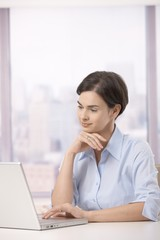 Female office worker with laptop
