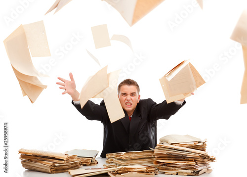Man throwing away paperwork