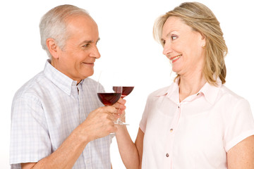 Elderly couple drinking wine