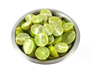 Sliced key limes in stainless steel bowl