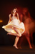 Beautiful young female wearing dress, dancing, multiple exposure