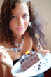Beautiful girl eating cake. Shallow depth of field